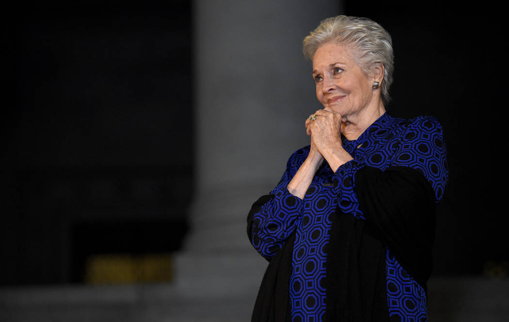 """Lee Meriwether, who played Catwoman in """"Batman: The Movie,"""" watches during a tribute to """"Batman"""" star Adam West that included lighting a Bat-Signal at City Hall ..."""