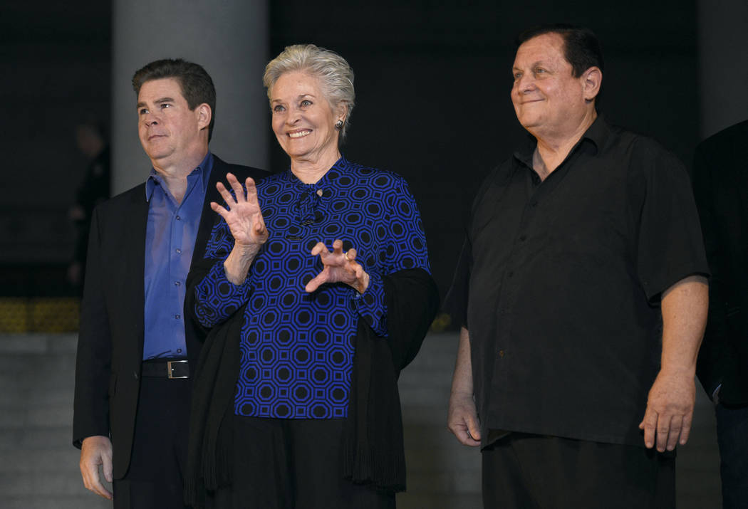 "Ralph Garman, left, Lee Meriwether and Burt Ward appear at a tribute to ""Batman"" star Adam West that included lighting a Bat-Signal at City Hall on Thursday, June 15, 2017, in Lo ..."