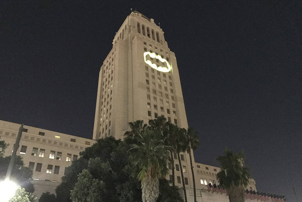 "The Bat-Signal is projected onto City Hall in Los Angeles on Thursday night, June 15, 2017, during a tribute to ""Batman"" actor Adam West, who died last week at age 88. (AP Photo/ ..."