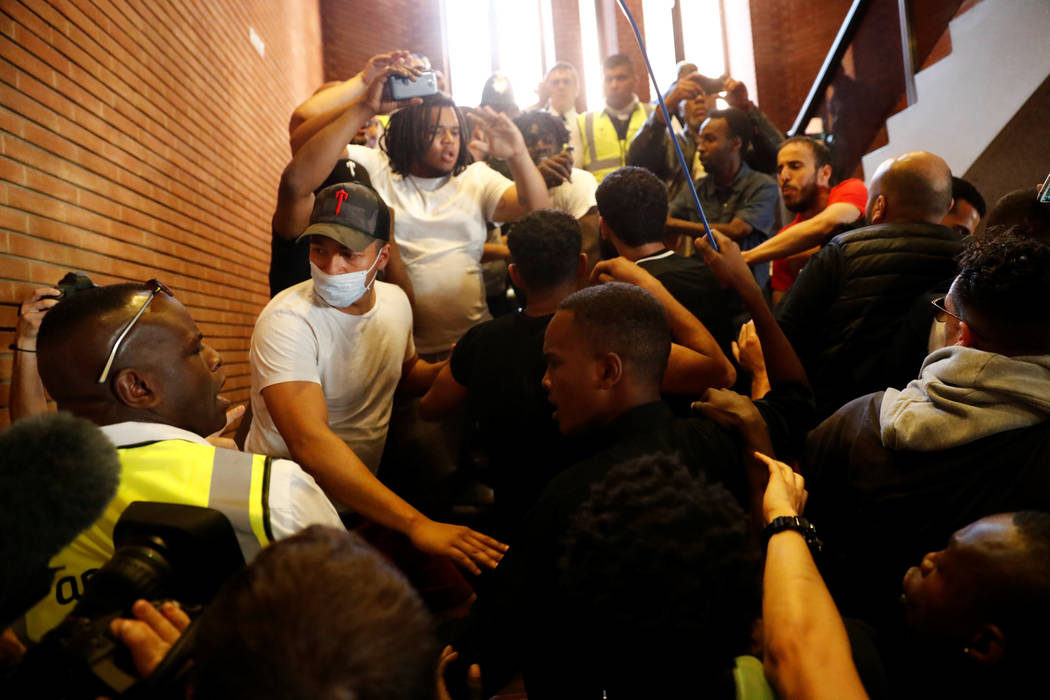 Demonstrators crowd onto a staircase as they enter Kensington Town Hall, during a protest following the fire that destroyed The Grenfell Tower block, in north Kensington, West London, Britain June ...