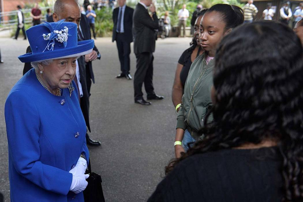 Queen Elizabeth meets residents of the Grenfell Tower block near the scene of the fire that destroyed the block, in north Kensington, West London, Britain June 16, 2017.  (Hannah McKay/Reuters)