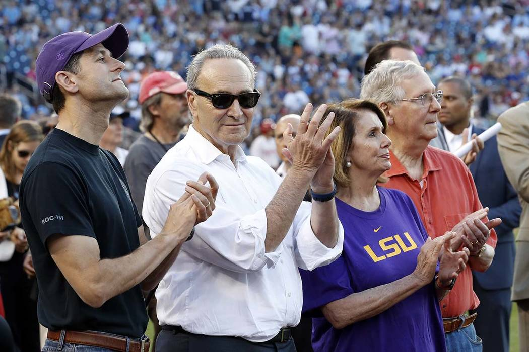 Speaker Paul Ryan of Wis., left, Senate Minority Leader Chuck Schumer of N.Y., House Minority Leader Nancy Pelosi of Calif., and Senate Majority Leader Mitch McConnell of Ky., applaud a message by ...