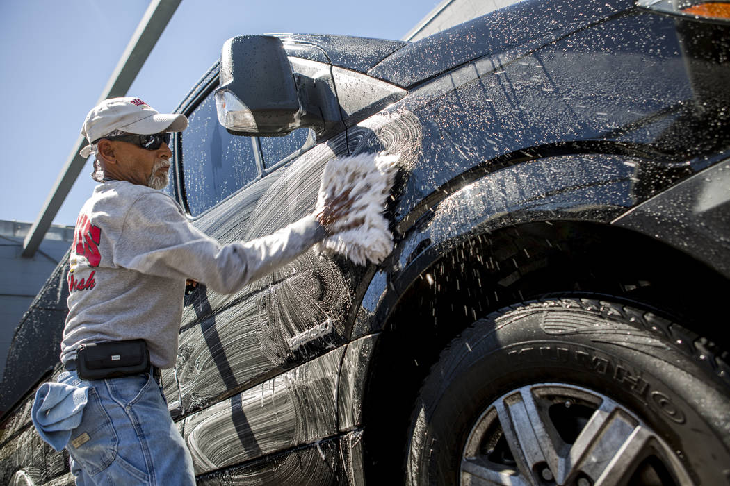 Enrique Suarez washes a Mercedes-Benz van as the temperature reached 105 at the Oasis Hand Car Wash on East Flamingo Road on Friday, June 16, 2017.  Patrick Connolly Las Vegas Review-Journal @PConnPie