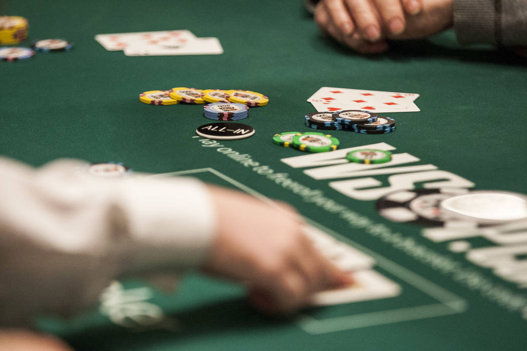 Chips and cards on the table as a player goes all-in during the $2,500 No-Limit Hold'em event in the World Series of Poker at the Rio Convention Center on Thursday, June 15, 2017.  Patrick Connoll ...