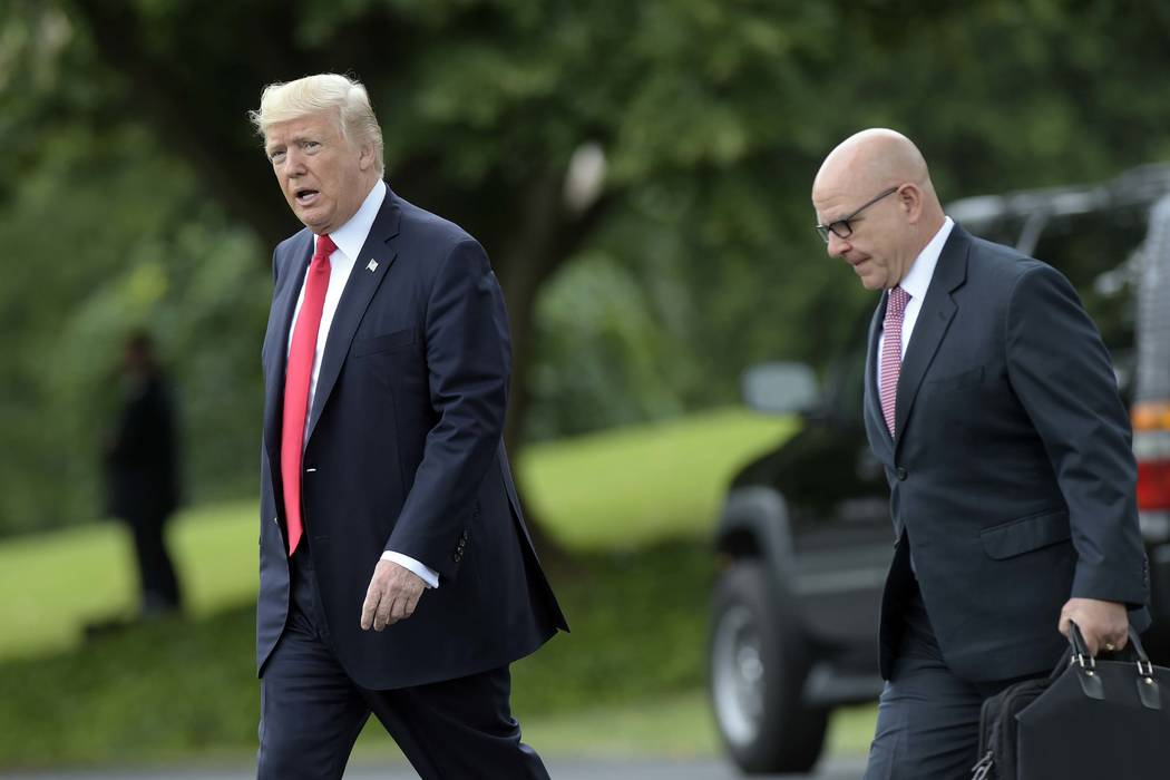 President Donald Trump walks with National Security Adviser H.R. McMaster from the Oval Office to Marine One at the White House in Washington, Friday, June 16, 2017, as he heads to Miami. (Susan W ...