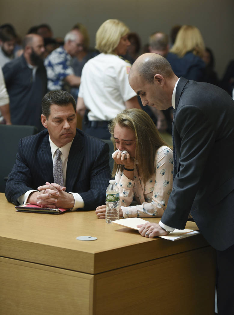 Michelle Carter cries while flanked by defense attorneys Joseph Cataldo, left, and Cory Madera, after being found guilty of involuntary manslaughter in the suicide of Conrad Roy III, Friday, June  ...