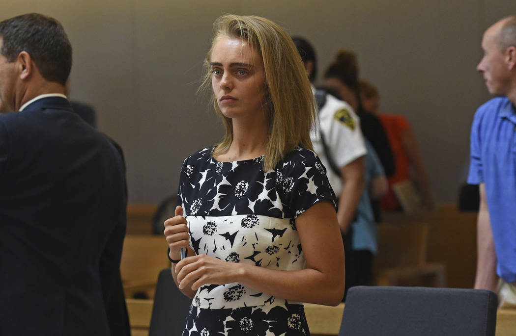 In this Monday, June 12, 2017 file photo, Michelle Carter stands as court is in recess at the end of the day at her trial in Taunton, Mass. Carter is charged with involuntary manslaughter for enco ...