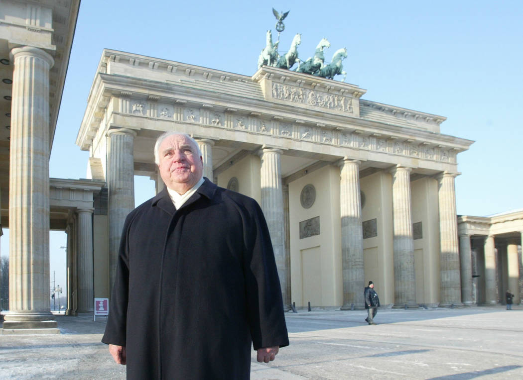 The Jan. 8, 2003 file photo shows former German Chancellor Helmut Kohl passing the Brandenburg Gate during a private walk in Berlin. (Jan Bauer/AP)