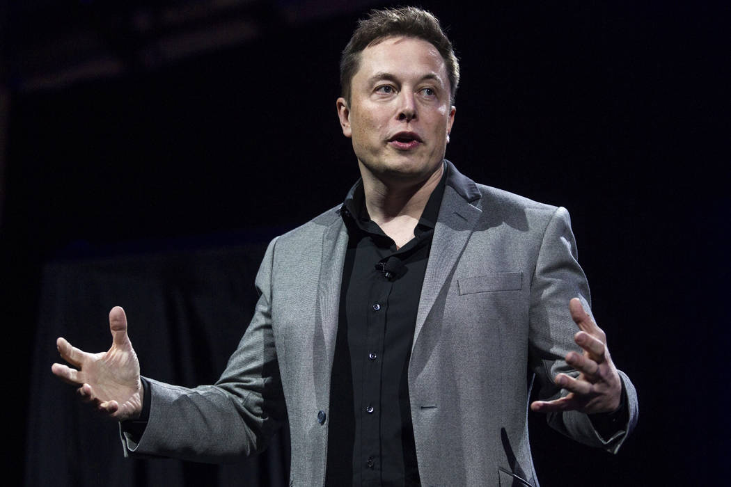 In this April 30, 2015, file photo, Tesla Motors CEO Elon Musk unveils the company's newest products, in Hawthorne, Calif. (Ringo H.W. Chiu/AP)