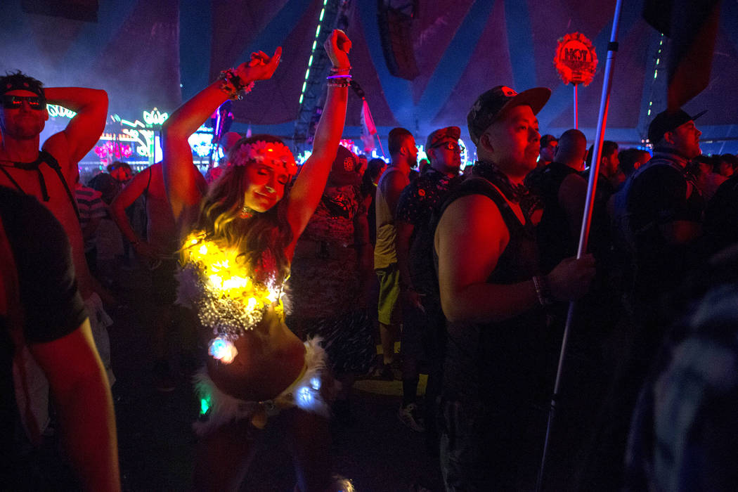 Agnieszka Salamon from Poland, dances at Neon Garden on the first night of Electric Daisy Carnival at Las Vegas Motor Speedway in the early morning of  Saturday, June 17, 2017 in Las Vegas. Bridge ...