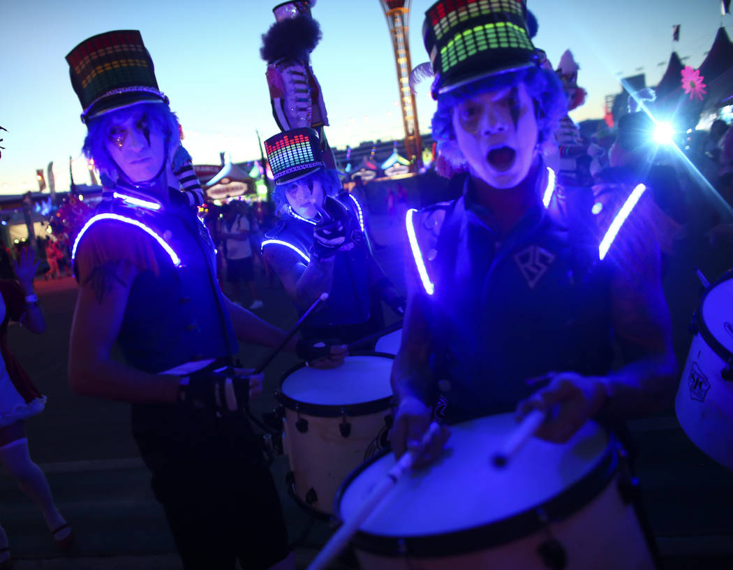 Costumed performers roam the crowd during the first day of the Electric Daisy Carnival at the Las Vegas Motor Speedway on Friday, June 16, 2017. Chase Stevens Las Vegas Review-Journal @csstevensphoto
