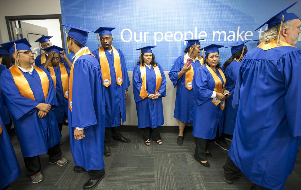 Walmart graduates line up before the start of the Walmart Academy graduation on Tuesday, June 20, 2017. (Richard Brian/Las Vegas Review-Journal) @vegasphotograph