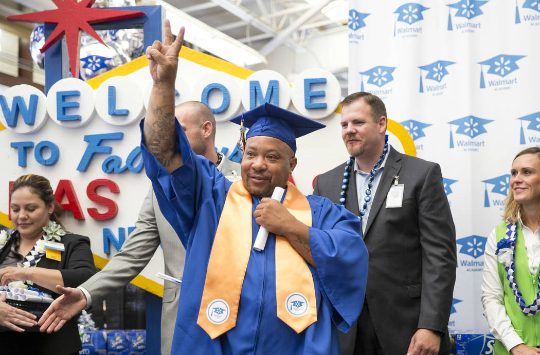Walmart Produce Department Manager Jamal Barron acknowledges the crowd after receiving his diploma during the Walmart Academy graduation ceremony on Tuesday, June 20, 2017. (Richard Brian/Las Vega ...