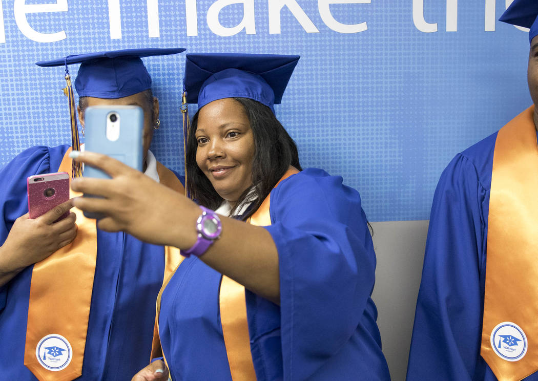 Walmart Support Manager Thea Dightmon takes a selfie with a colleague before the start of the Walmart Academy graduation ceremony on Tuesday, June 20, 2017. (Richard Brian/Las Vegas Review-Journal ...