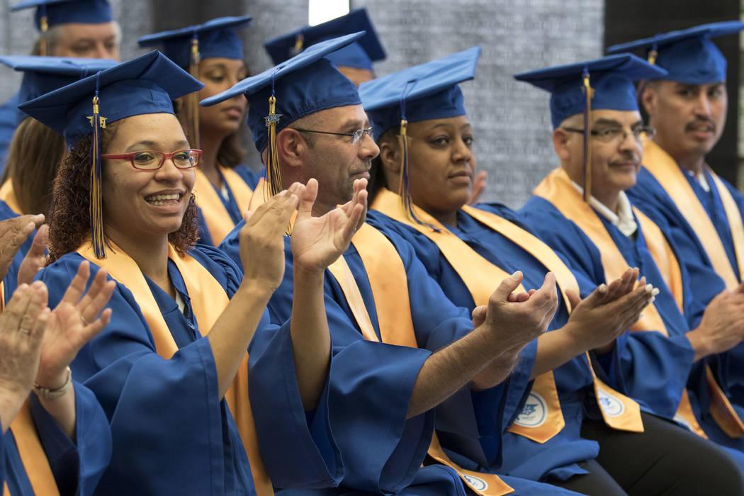 Walmart graduates, including Amanda Allison, left, applaud during the Walmart Academy graduation ceremony on Tuesday, June 20, 2017. (Richard Brian/Las Vegas Review-Journal) @vegasphotograph