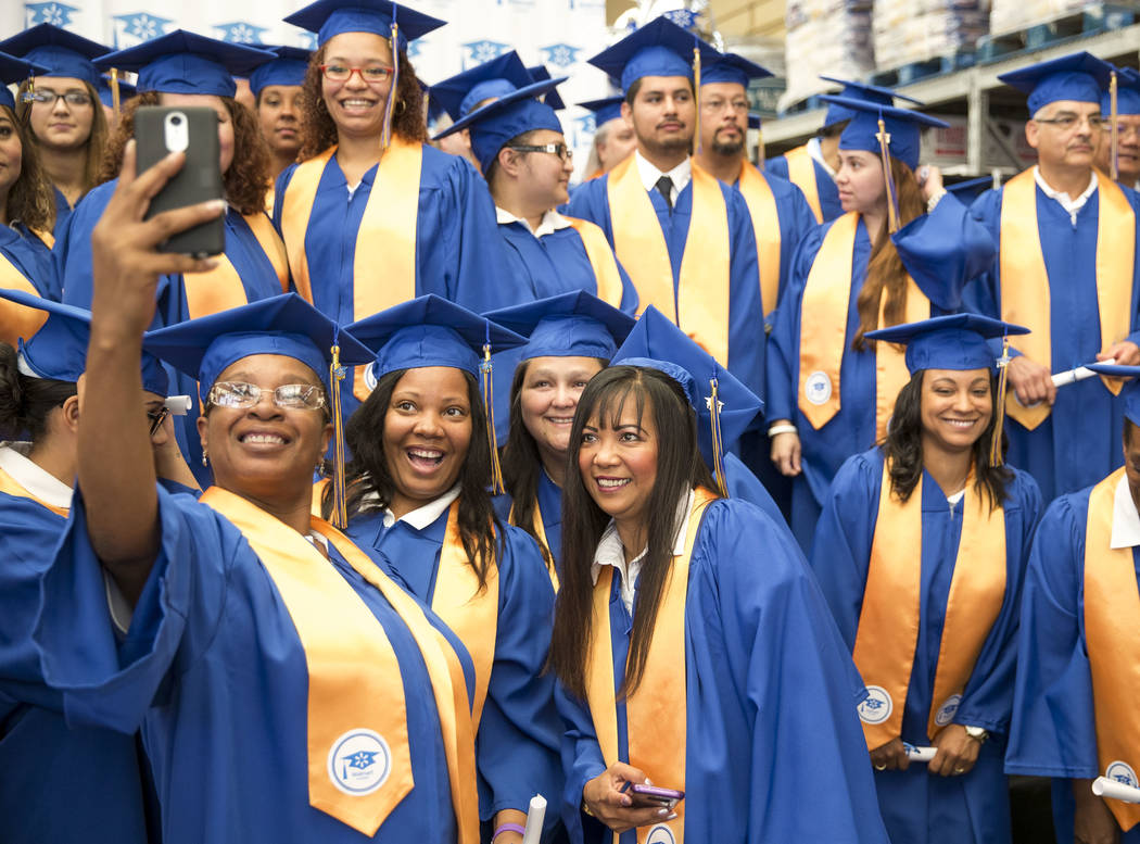 Graduates gather for a selfie after receiving their diplomas during the Walmart Academy graduation ceremony on Tuesday, June 20, 2017. (Richard Brian/Las Vegas Review-Journal) @vegasphotograph