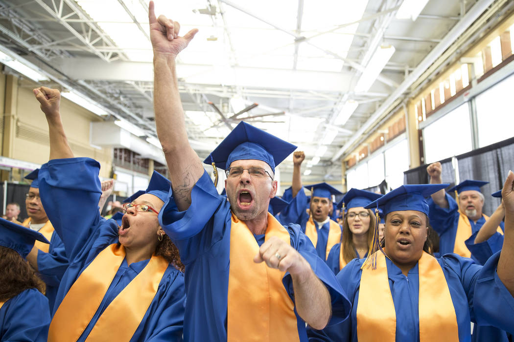 Walmart Overnight Support Manager Michael Alexander, center, celebrates with colleagues during the Walmart Academy graduation ceremony on Tuesday, June 20, 2017. (Richard Brian/Las Vegas Review-Jo ...