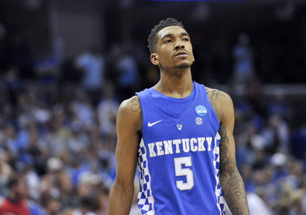 Kentucky guard Malik Monk (5) walks to the bench after North Carolina's Luke Maye hit the winning basket in the second half of the South Regional final game against Kentucky in the NCAA college ba ...