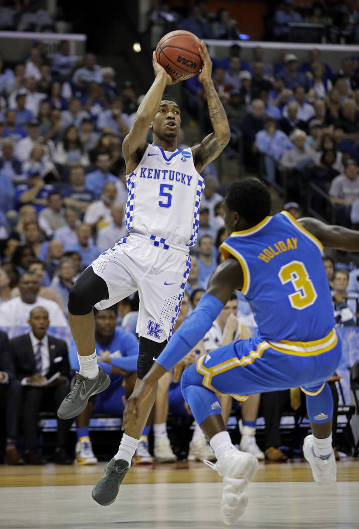Kentucky guard Malik Monk (5) shoots over UCLA guard Aaron Holiday (3) in the first half of an NCAA college basketball tournament South Regional semifinal game Friday, March 24, 2017, in Memphis,  ...