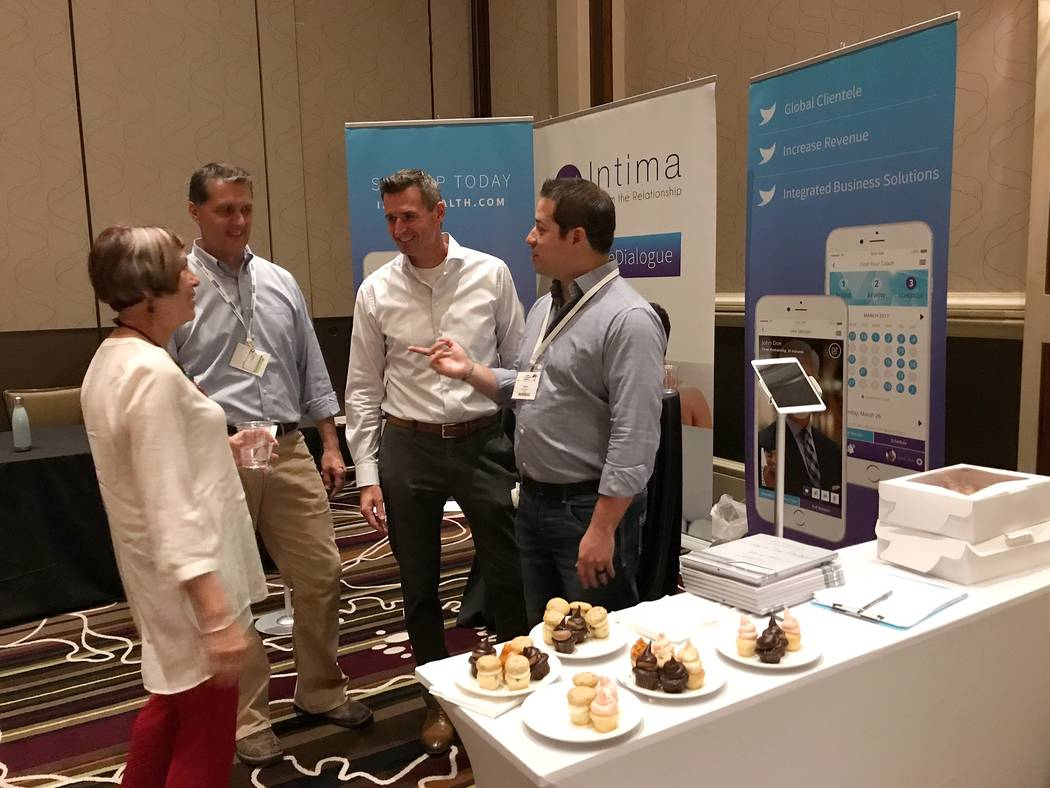 Josh Mercer, far right, founder of Intima application, talks to an AASECT attendee at Green Valley Ranch Resort in Henderson, Nev., on Friday, June 16, 2017. Todd Prince Las Vegas Review-Journal