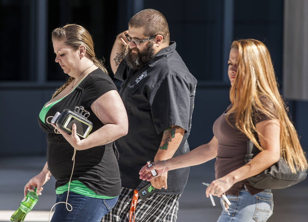 Supporters of arrested Vagos Outlaw Motorcycle Gang members walk out of the Lloyd George U.S. Courthouse in downtown Las Vegas on Friday, June 16, 2017.  Patrick Connolly Las Vegas Review-Journal  ...