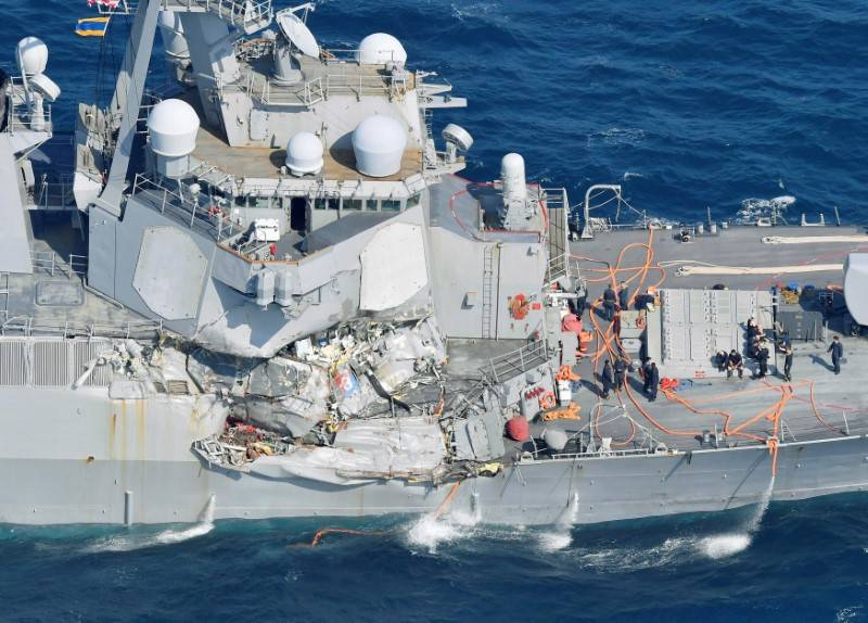 The Arleigh Burke-class guided-missile destroyer USS Fitzgerald, damaged by colliding with a Philippine-flagged merchant vessel, is seen off Shimoda, Japan in this photo taken by Kyodo June 17, 20 ...