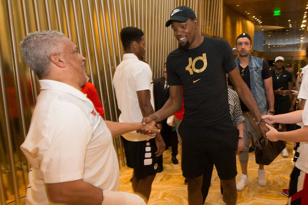 UNLV men's basketball coach Marvin Menzies greets Warriors star Kevin Durant at Aria on Thursday, June 15, 2017 (UNLV athletics)