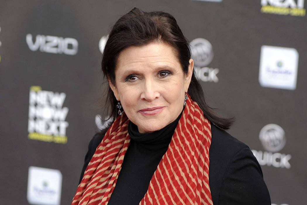 Carrie Fisher is seen at the 2011 NewNowNext Awards in Los Angeles. (AP Photo/Chris Pizzello, File)