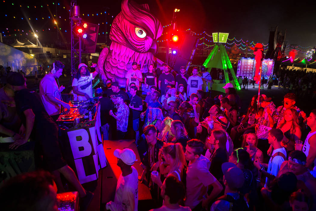 Attendees grove on Parliament art car, the newest addition to the festival's art cars, on the first night of Electric Daisy Carnival at Las Vegas Motor Speedway on Friday, June 16, 2017 in Las Veg ...