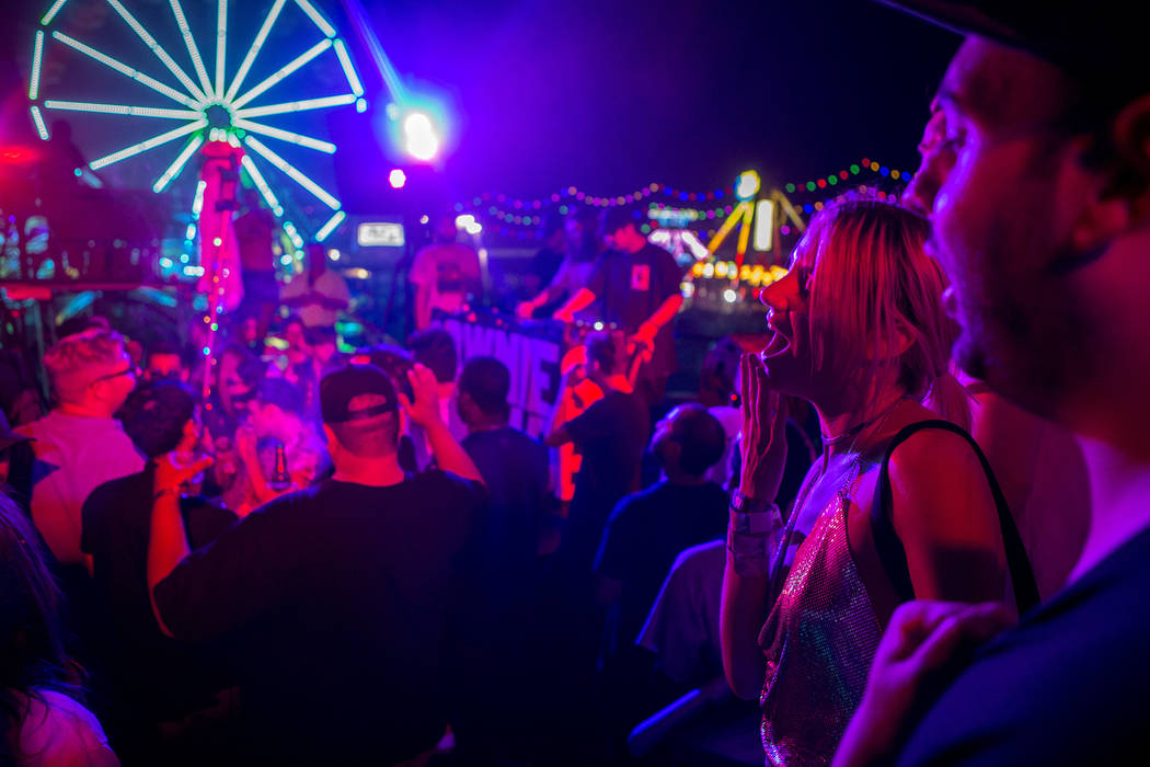 Attendees enjoy a set on Parliament art car, the newest addition to the festival's art cars, on the first night of Electric Daisy Carnival at Las Vegas Motor Speedway on Friday, June 16, 2017 in L ...