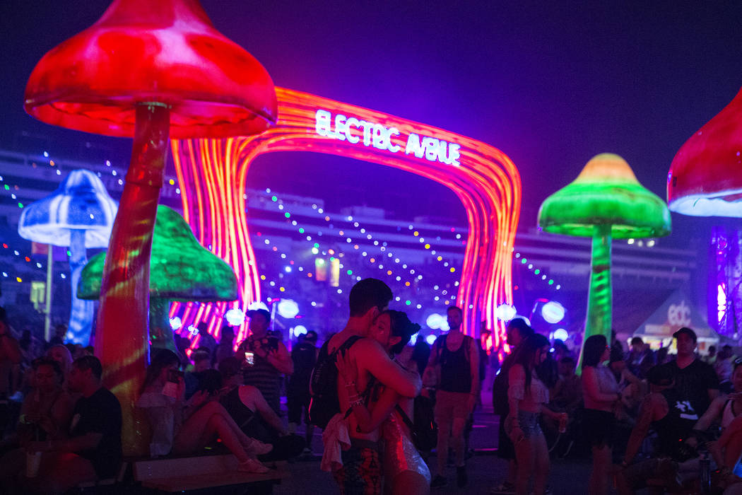 Tony Russo, left, and Laura Nguyen hug under the Electric Avenue sign on the first night of Electric Daisy Carnival at Las Vegas Motor Speedway in the early morning of Saturday, June 17, 2017 in L ...