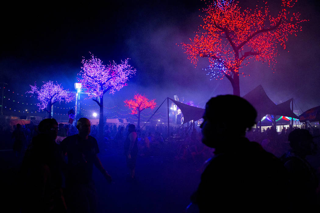 Attendees make their way through the festival grounds on the first night of Electric Daisy Carnival at Las Vegas Motor Speedway in the early morning of  Saturday, June 17, 2017 in Las Vegas. Bridg ...