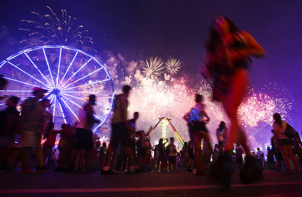 Attendees pass by as fireworks go off during the first day of the Electric Daisy Carnival at the Las Vegas Motor Speedway on Saturday, June 17, 2017. Chase Stevens Las Vegas Review-Journal @csstev ...