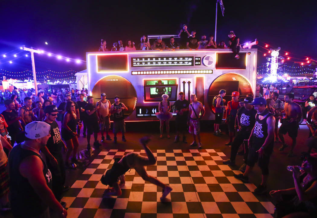 Breakdancers take turns showing off their moves by an art car during the first day of the Electric Daisy Carnival at the Las Vegas Motor Speedway on Saturday, June 17, 2017. Chase Stevens Las Vega ...