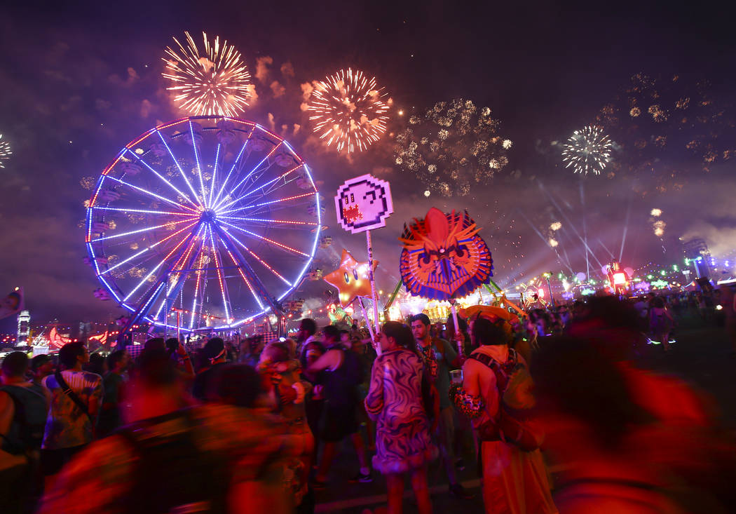Attendees watch as fireworks go off during the first day of the Electric Daisy Carnival at the Las Vegas Motor Speedway on Saturday, June 17, 2017. Chase Stevens Las Vegas Review-Journal @cssteven ...