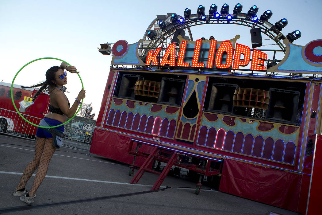 Alexis Ortiz from Phoenix hula hoops in front of the Kalliope Art Car on the first night of Electric Daisy Carnival at Las Vegas Motor Speedway on Friday, June 16, 2017 in Las Vegas. Bridget Benne ...