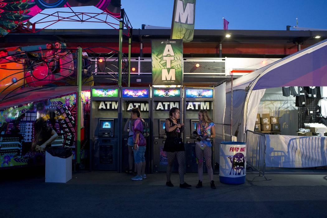 Attendees gather at ATMs on the first night of Electric Daisy Carnival at Las Vegas Motor Speedway on Friday, June 16, 2017 in Las Vegas. Bridget Bennett Las Vegas Review-Journal @bridgetkbennett