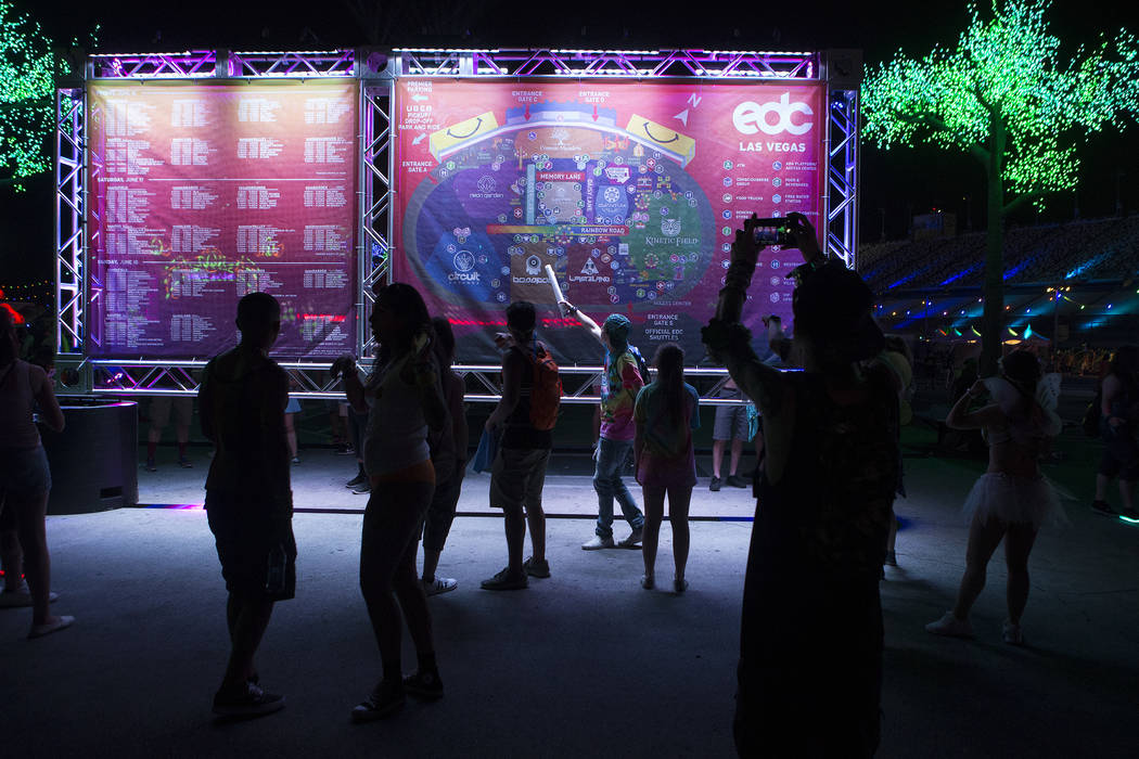 Attendees look at a map of the festival grounds on the first night of Electric Daisy Carnival at Las Vegas Motor Speedway on Friday, June 16, 2017 in Las Vegas. Bridget Bennett Las Vegas Review-Jo ...