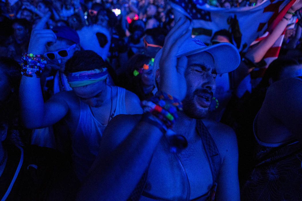Kennan Billimoria, right, from San Diego, enjoys San Holo's set at Cosmic Meadow on the first night of Electric Daisy Carnival at Las Vegas Motor Speedway on Friday, June 16, 2017 in Las Vegas. Br ...