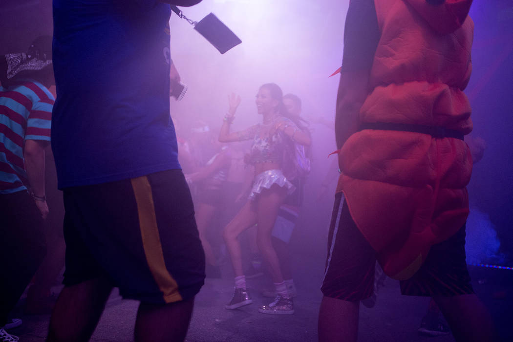Marilyn Monroy, center, from the Bay Area dances at the Upside-down House on the first night of Electric Daisy Carnival at Las Vegas Motor Speedway on Friday, June 16, 2017 in Las Vegas. Bridget B ...
