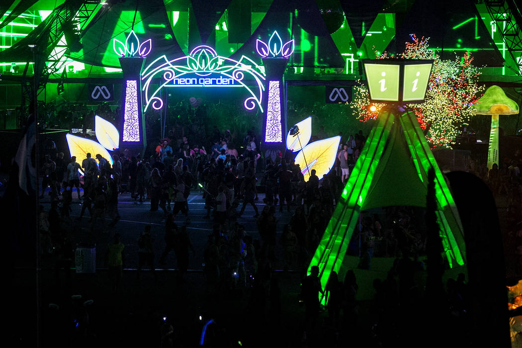 Attendees pass the entrance of Neon Garden on the first night of Electric Daisy Carnival at Las Vegas Motor Speedway on Friday, June 16, 2017 in Las Vegas. Bridget Bennett Las Vegas Review-Journal ...