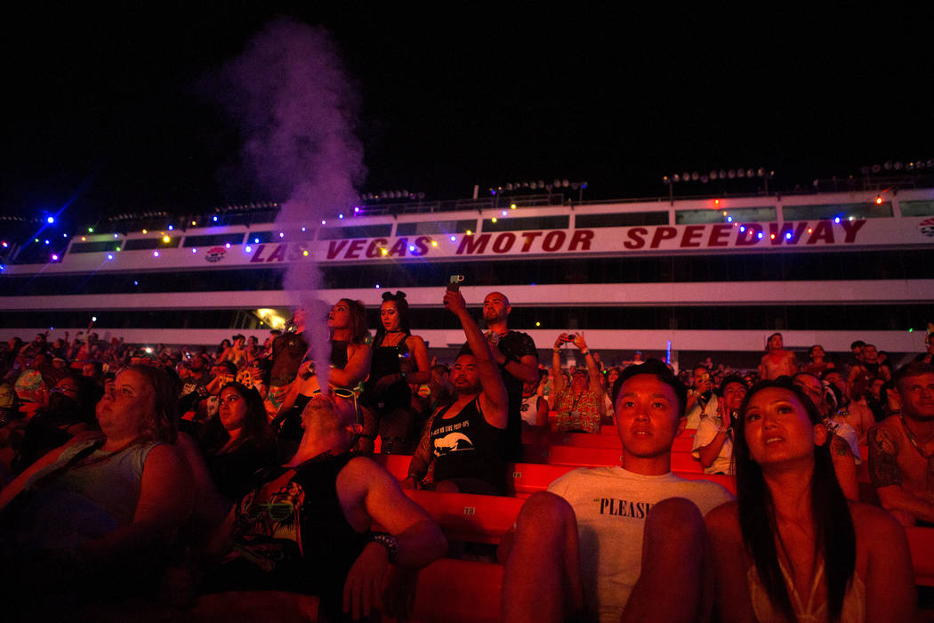 Attendees take to the stands during Major Lazer's set at Cosmic Meadows on the first night of Electric Daisy Carnival at Las Vegas Motor Speedway on Saturday, June 17, 2017 in Las Vegas. Bridget B ...