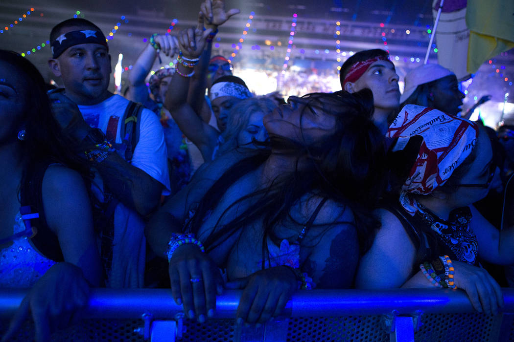Stephanie Martinez from San Jose, Calif. whips her hair as she dances during Major Lazer's set at Cosmic Meadows on the first night of Electric Daisy Carnival at Las Vegas Motor Speedway on Saturd ...