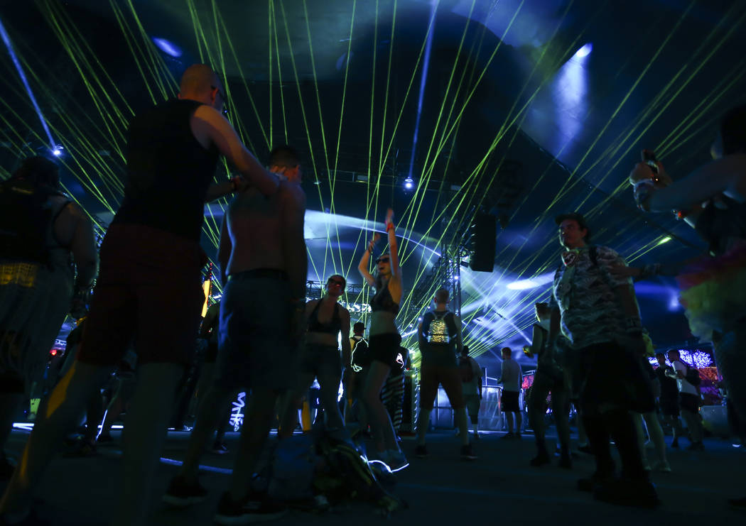 Fans dance as John Askew performs at the Quantum Valley stage during the first day of the Electric Daisy Carnival at the Las Vegas Motor Speedway on Friday, June 16, 2017. Chase Stevens Las Vegas  ...