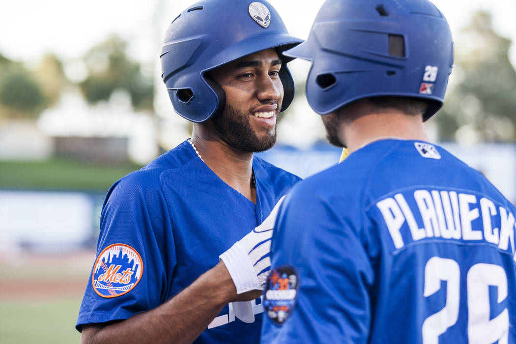 Amed Rosario shares a moment with Kevin Plawecki while coming off the field during Las Vegas 51s game against the Sacramento River Cats at Cashman Field on Friday, June 16, 2017. The River Cats wo ...