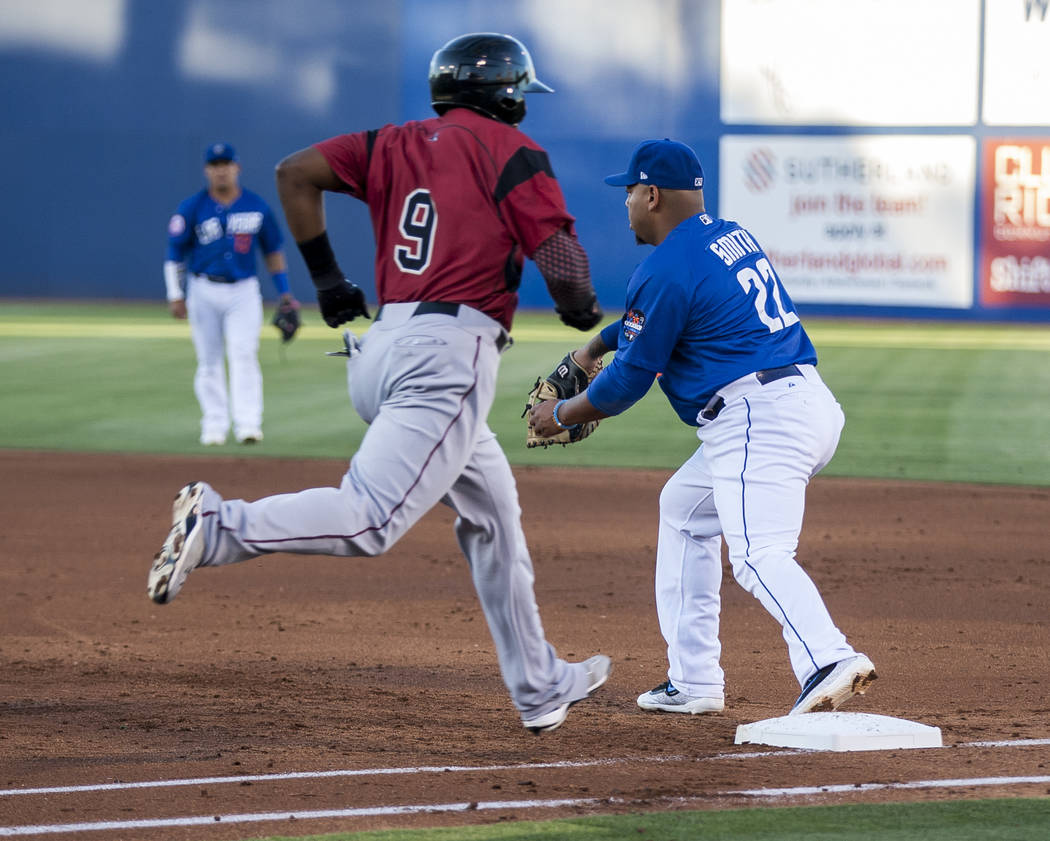 Dominic Smith tags Sacramento's Carlos Moncrief out at first base during Las Vegas 51s game against the Sacramento River Cats at Cashman Field on Friday, June 16, 2017. The River Cats won 6-4.  Pa ...