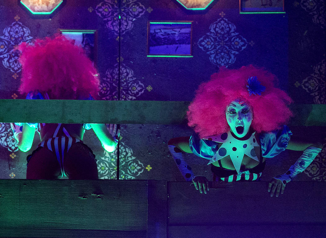 Costumed performers dace at the Upside-down House on the second night of Electric Daisy Carnival at Las Vegas Motor Speedway on Saturday, June 17, 2017 in Las Vegas. Bridget Bennett Las Vegas Revi ...