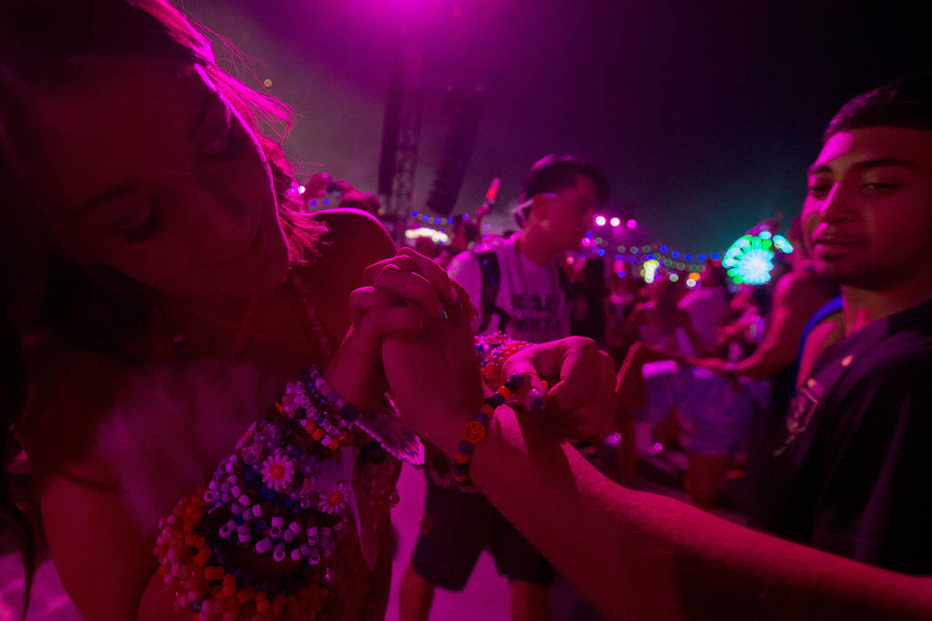 Cassie Kaiser from Phoenix exchanges kandi with Salt Joeu from Dallas in the crowd of Kinetic Field on the second night of Electric Daisy Carnival at Las Vegas Motor Speedway on Saturday, June 17, ...