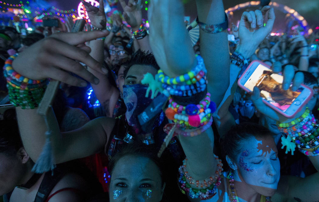 Attendees dance during Dillon Francis's set at Kinetic Field on the second night of Electric Daisy Carnival at Las Vegas Motor Speedway on Sunday, June 18, 2017 in Las Vegas. Bridget Bennett Las V ...