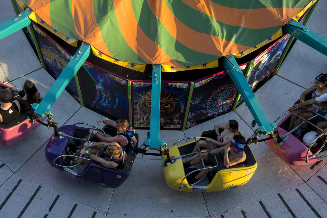Attendees enjoy one of many rides at the festival on the last night of Electric Daisy Carnival at Las Vegas Motor Speedway on Sunday, June 18, 2017 in Las Vegas. Bridget Bennett Las Vegas Review-J ...